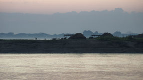 Sunrise at a village at the Irrawaddy Stock Image