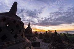 Sunrise vivid sky front of Borobudur Royalty Free Stock Photography