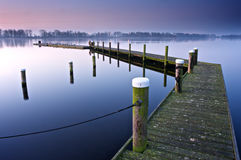 Sunrise at Vlietlanden. A jetty in the tranquil first hours of the day Stock Photos