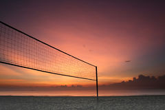 Sunrise volleyball. Sillhouette of a volleyball net against sunrise on the beach Royalty Free Stock Photography