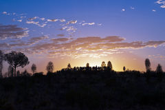 Sunrise watching on Ayers Rock royalty free stock photos