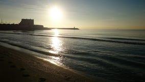 Sunrise. Watching sunrise by the seaside Royalty Free Stock Image