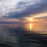 Sunrise on the water Royalty Free Stock Images
