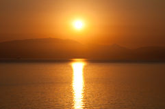 Sunrise on the water. Greece. Stock Photos