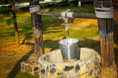 Sunrise and Water-well. At Thailand Stock Image