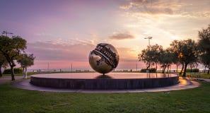 Sunrise on the waterfront of Pesaro. Marche region, Italy - Sunrise on the waterfront of Pesaro. HDRnsculpture by Arnaldo Pomodoro at sunrise called `Tomato`s stock image