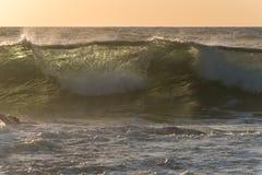 Sunrise wave with back light Stock Image
