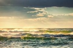 Sunrise Wave. Ocean Waves crashing onto the shore. Beautiful green sunrise wave. Ocean Waves crashing onto the shore Royalty Free Stock Image