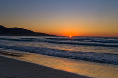 Sunrise and waves at the golden beach, Thassos island Royalty Free Stock Images