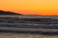 Sunrise and waves at golden beach, Thassos island Stock Photo
