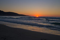 Sunrise and waves at golden beach, Thassos island Stock Image