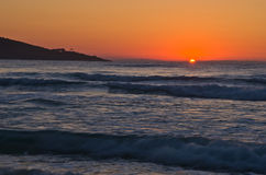 Sunrise and waves at golden beach, Thassos island Royalty Free Stock Images