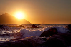 Sunrise, waves and Mount Athos Stock Photography