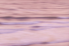 Sunrise waves. Ocean waves at sunrise abstract, in-camera motion blur. Florida, Atlantic coast, aerial view Stock Photos