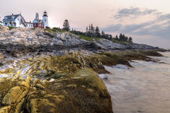 Sunrise Waves on Pemaquid Point. Dawn at the Pemaquid Point Light, as waves lap against intreresting layers of rock formations, on the mid coast of Maine Stock Images