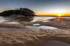 Sunrise where the river meets the ocean Stock Photography