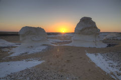 Sunrise at the white desert. The sun is coming up at the white desert in Egypt Royalty Free Stock Photography