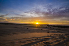 Sunrise at White sand dune, Mui Ne, Vietnam. Royalty Free Stock Image