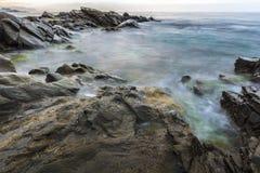Sunrise at Wilches Beach, Torrox Coast, Malaga. Spain. Visible taro or haze at bottom Royalty Free Stock Photo