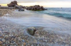 Sunrise at Wilches Beach, Torrox Coast, Malaga. Spain. Visible taro or haze at bottom Stock Image