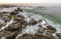 Sunrise at Wilches Beach, Torrox Coast, Malaga. Spain. Visible taro or haze at bottom Royalty Free Stock Image