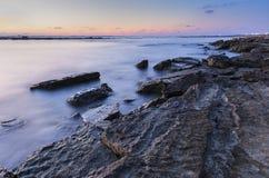 Sunrise on the wild beach of the Caspian Sea coast near Baku. Nature royalty free stock image