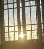 SUNRISE THROUGH WINDOW royalty free stock photography