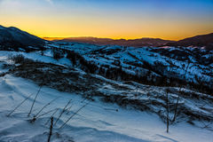Sunrise in winter carpathians. Carpathian mountain rural area near peaks in snow on frosty sunrise in winter Royalty Free Stock Image