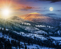 Sunrise in winter carpathians 24 hour concept. 24 hour a day concept image of carpathian mountain rural area near peaks in snow on frosty sunrise in winter Royalty Free Stock Photo