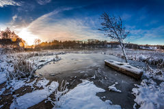 Sunrise in winter lake covered with snow Stock Photo