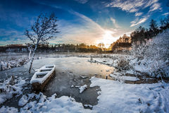 Sunrise on winter lake covered with snow Stock Photography