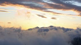 Sunrise Winter Mountain Landscape. Smooth video panorama top-down of sunrise winter mountain . Visible the movement of the clouds stock footage