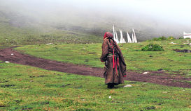 Sunrise, a woman walked trod. Tibetan lady walked trod at morning Royalty Free Stock Photography