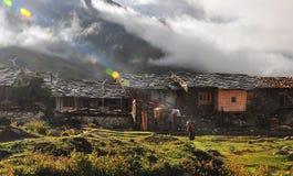 Sunrise, a woman walked Village. Tibetan lady walked Village at morning Stock Images