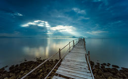 Sunrise on the wooden bridge. With sun ray in long exposure photo Stock Photography