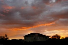 Sunrise and wooden house, new zealand Royalty Free Stock Images
