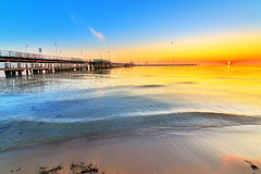 Sunrise at wooden pier on Baltic sea. Sunrise at wooden pier in Sopot on Baltic sea, Poland Royalty Free Stock Photography