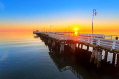 Sunrise at wooden pier on Baltic sea. Sunrise at wooden pier in Sopot on Baltic sea, Poland Royalty Free Stock Photo