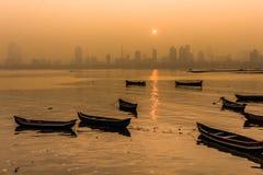 Sunrise at worli bay. Fishing Boats at worli bay at sunrise stock photo