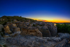 Sunrise at Writing on Stone Provincial Park in Alberta, Canada. Golden sunrise over the Hoodoo badlands at Writing on Stone Provincial Park and Áísínai`pi Stock Photography