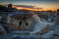 Sunrise at Writing on Stone Provincial Park in Alberta, Canada. Golden sunrise over the Hoodoo badlands at Writing on Stone Provincial Park and Aisinaipi Stock Images