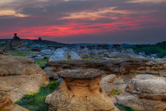 Sunrise at Writing on Stone Provincial Park in Alberta, Canada. Golden sunrise over the Hoodoo badlands at Writing on Stone Provincial Park and Aisinaipi Stock Photography