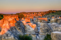 Sunrise at Writing-on-Stone Provincial Park in Alberta, Canada. Sunrise shining over the Hoodoo badlands at Writing-on-Stone Provincial Park in Alberta, Canada Stock Photography