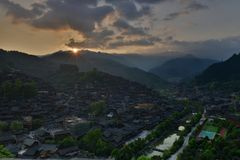 The sunrise in Xijiang Qianhu Miao Village. Located on the north side of Leigong Hill, Xijiang Qianhu Miao Village is about 35 km 22 miles away from Kaili city stock photo