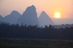 Sunrise in Yangshuo. Sunrise with karst mountains in Yangshuo, China Royalty Free Stock Images