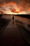 Sunrise Yellowstone Geysers with Man Silhouetted Stock Photography