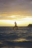 Sunrise yoga on paddle board Stock Image