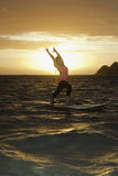 Sunrise yoga on paddle board Royalty Free Stock Photo