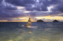 Sunrise yoga on paddle board Stock Images