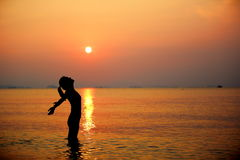 Sunrise cheering woman open arms  Stock Photography